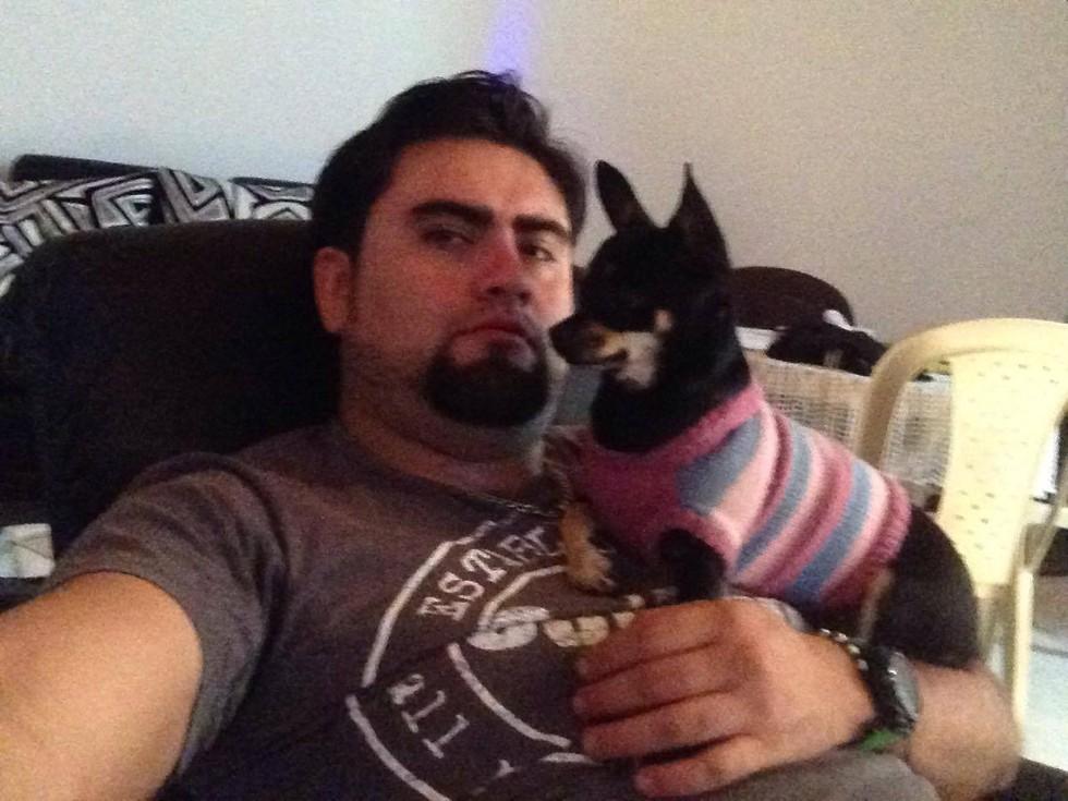 Diego Andrés Dávila Jimenez with a dog, Facebook