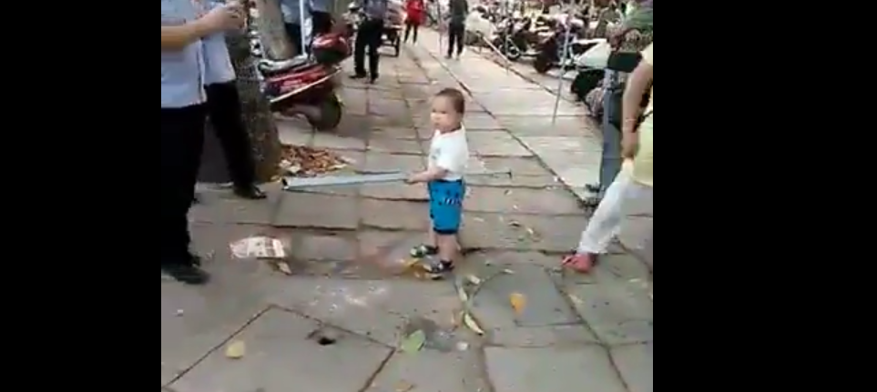 Toddler with a Metal Pipe, People's Daily ????
